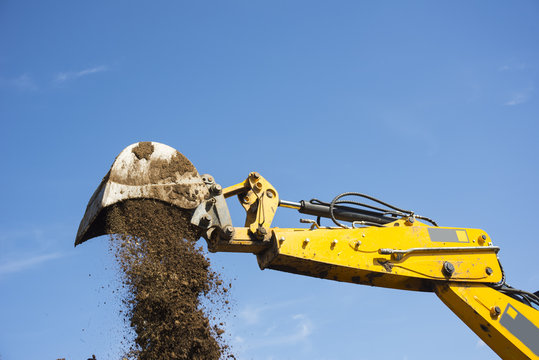 Shovel bucket against the blue sky, lift loads, construction mac