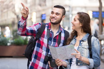 Tourist couple with map in the city.