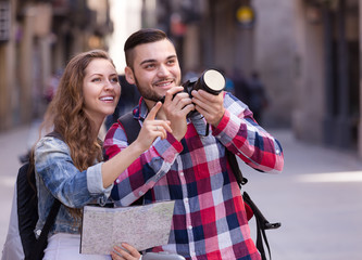 tourists taking pictures outdoors
