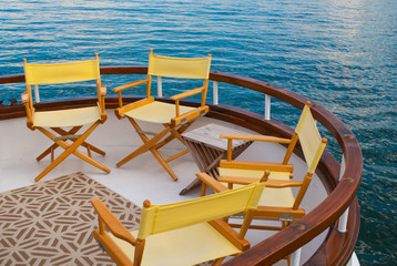 Yellow Chairs on a Sailboat Deck