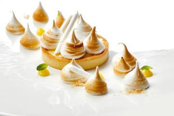Tartlet with lemon curd and meringue horizontal close-up. desser
