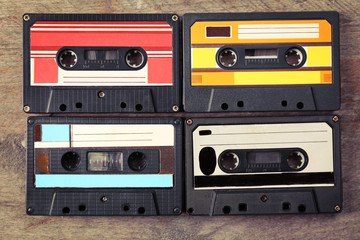 Group of retro cassettes on wooden table, closeup