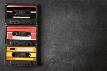 Group of retro cassettes on gray background, copy space