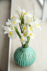 Fresh white irises on windowsill closeup