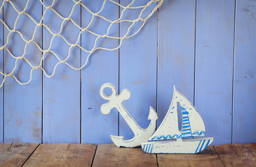 nautical life style objects on wooden table. vintage filtered.
