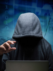 hacker with computer notebook