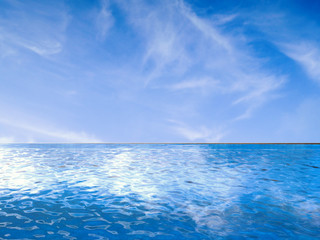 infinity pool with blue sea and blue sky