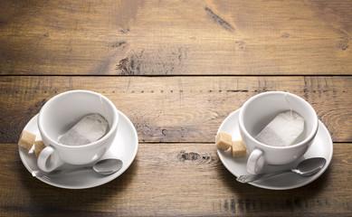 Set of two ceramic tea mugs with tea bags