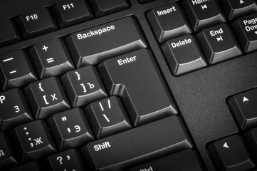 Electronic collection - black computer keyboard. The focus on the Enter key.