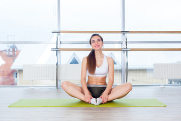 Young woman in a lotus position relax