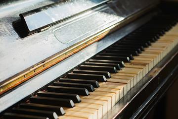 Old rusty piano keyboard, selective focus