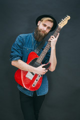 Hipster portrait of man with an electric guitar