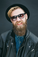 Portrait of hipster man in a studio