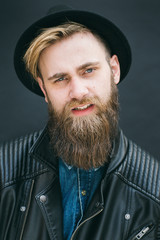Hipster portrait of man in a studio