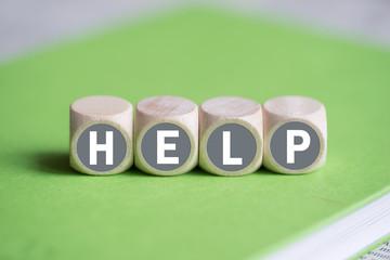 """Würfel mit Wort """"Help"""""""
