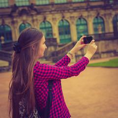 Young woman take photo Frauenkirche in Dresden