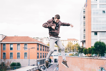 young hansome man jumping from wall