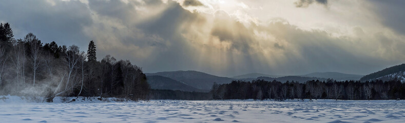 Light from the clouds over the river Irkut