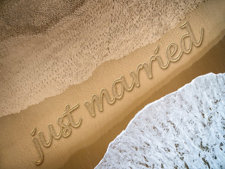 Just Married written on the beach