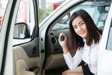 Young Happy Woman Showing The Key Of her New Car, Dream comes tr