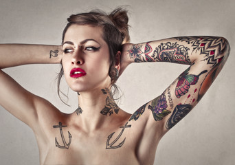 Beautiful tattooed woman with red lipstick