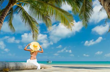 Woman enjoying her holidays on the beach