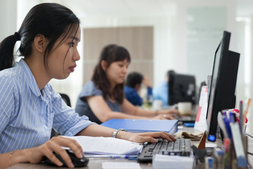 Asian businesswomen working computer sitting office