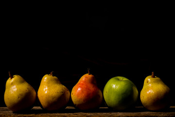 Delicious fruit on a wooden board, with black background
