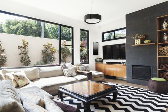 Monochrome living room with wood and grey tiling accents