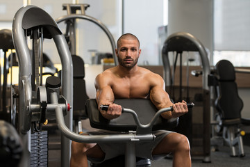 Bodybuilder Exercising Biceps