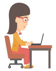 Woman working at laptop.