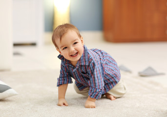 Cute baby on the floor in the room
