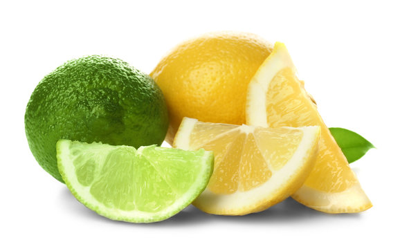 Ripe lime and lemon with slices isolated on white