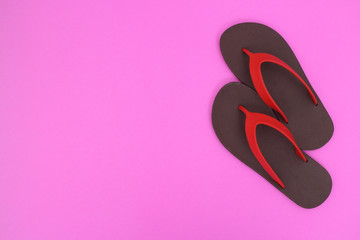 Flip flops isolated on pink  background. Top view