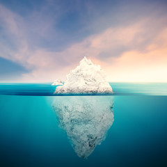 iceberg with cloudy sky