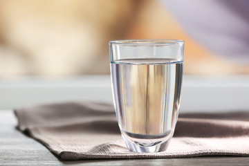 Glass of water on a  napkin, close up