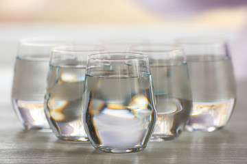 Glasses of water on wooden background