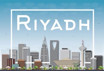 Riyadh skyline with gray buildings and blue sky.