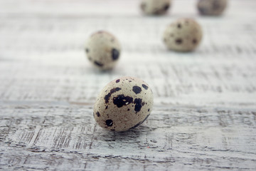 Quail eggs on rustic wooden background. Soft view