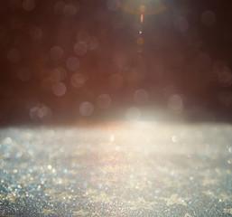 glitter vintage lights background. gold, silver and black. defoc