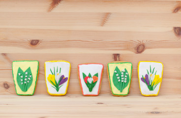 spring easter gingerbread with flowers on the wooden background