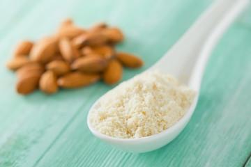almond flour on wooden surface