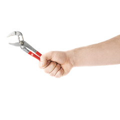 Hand holding a plumber wrench tool, composition isolated over the white background