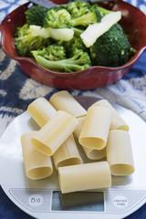 raw paccheri of gragnano on a kitchen scale