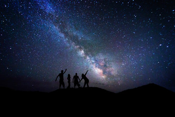 Peoples admiring the center of milky way in a night full of stars