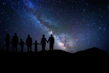Entire family who admires the milky way