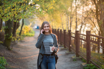 girl walking park with coffee