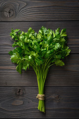bunch of parsley on wooden background