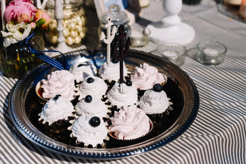 Candy bar. Table with sweet candy. Wedding cake, nautical style