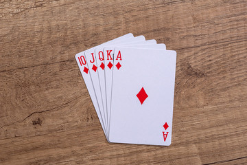 Set of Diamonds suit playing cards on wooden desk